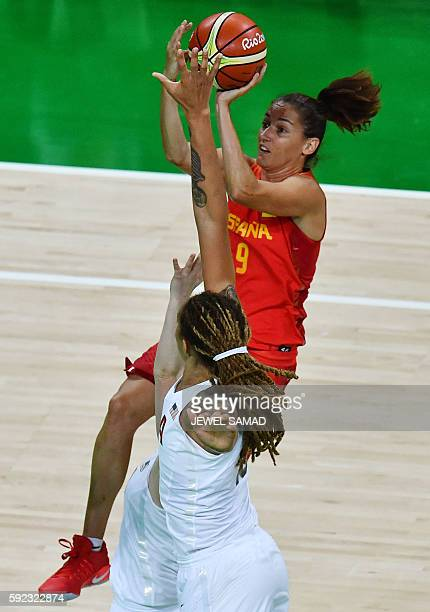 Spain's point guard Laia Palau jumps for a basket by USA's centre Brittney Griner during a Women's Gold medal basketball match between USA and Spain...