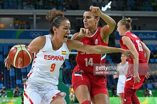Spain's point guard Laia Palau works around Serbia's shooting guard Ana Dabovic during a Women's semifinal basketball match between Spain and Serbia...