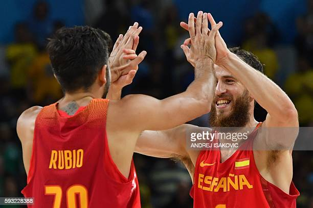 Spain's point guard Ricky Rubio and Spain's point guard Sergio Rodriguez celebrate after defeating Australia during a Men's Bronze medal basketball...