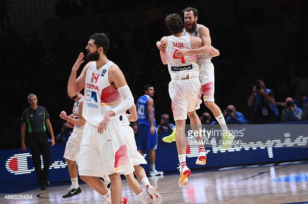 Spain's point guard Sergio Rodriguez and Spain's center Pau Gasol celebrate after Spain defeated Greece in their round of 8 basketball match at the...