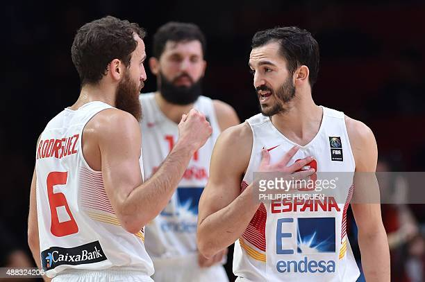 Spain's point guard Sergio Rodriguez and Spain's point guard Pau Ribas talk during the round of 8 basketball match between Spain and Greece at the...