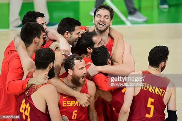 Spain's point guard Sergio Rodriguez Spain's centre Pau Gasol and Spain's players celebrate after defeating Australia during a Men's Bronze medal...