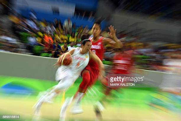 TOPSHOT Spain's point guard Silvia Dominguez works around Canada's power forward Miranda Ayim during a Women's round Group B basketball match between...