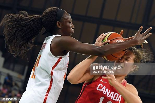 TOPSHOT Spain's power forward Astou Ndour defends against Canada's power forward Katherine Plouffe during a Women's round Group B basketball match...