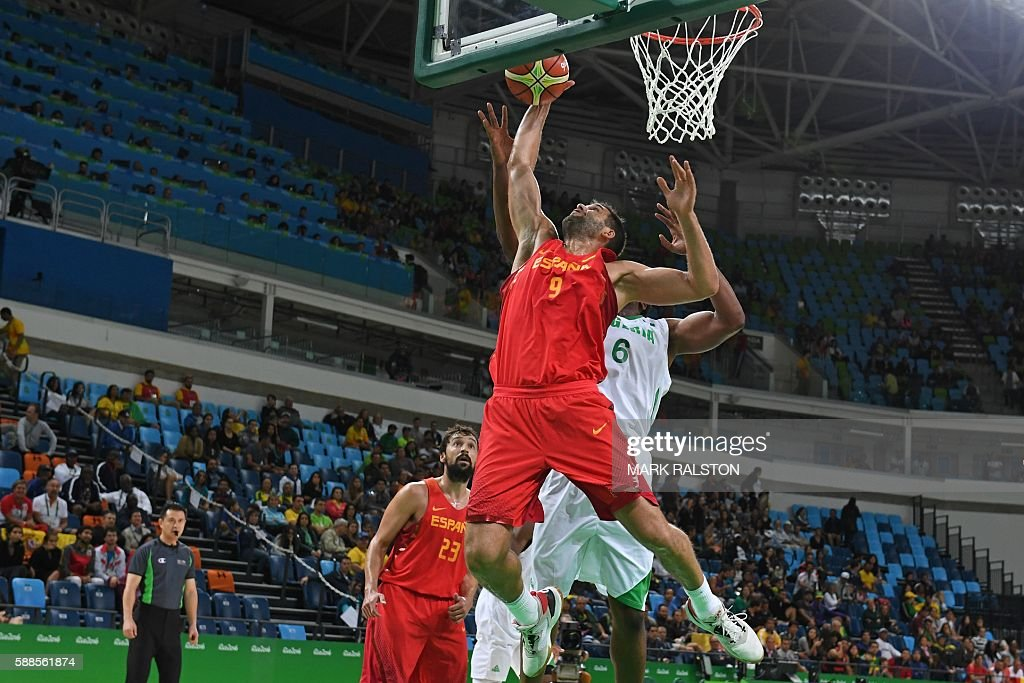 Spain's power forward Felipe Reyes and Nigeria's power forward Ike Diogu go for a rebound during a Men's round Group B basketball match between...
