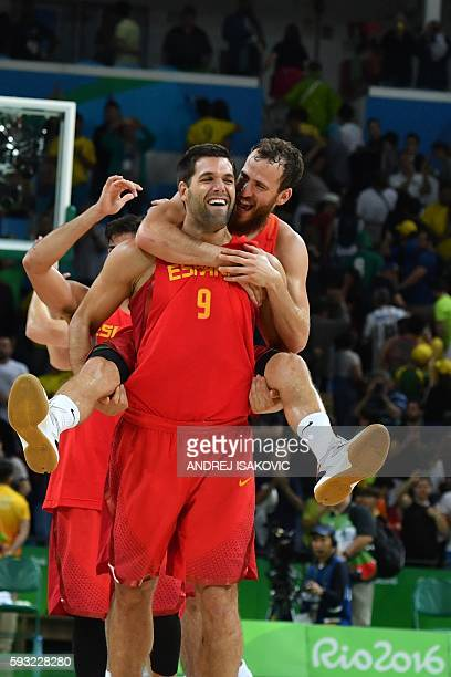 Spain's power forward Felipe Reyes and Spain's point guard Sergio Rodriguez reacts as Spain's players celebrate after defeating Australia during a...
