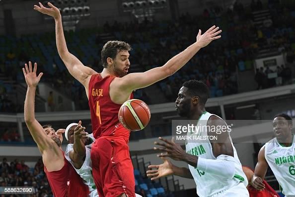 Spain's power forward Felipe Reyes Nigeria's point guard Josh Akognon Spain's centre Pau Gasol Nigeria's centre Ekene Ibekwe and Nigeria's power...