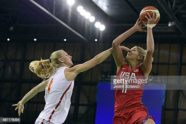 TOPSHOT Spain's power forward Laura Gil defends against USA's small forward Elena Delle Donne during a Women's round Group B basketball match between...