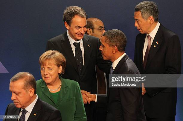 Spain's Prime Minister Jose Luis Rodriguez Zapater is greeted by USPresident Barack Obama as German Changellor Angela Merkel and Turkish Prime...