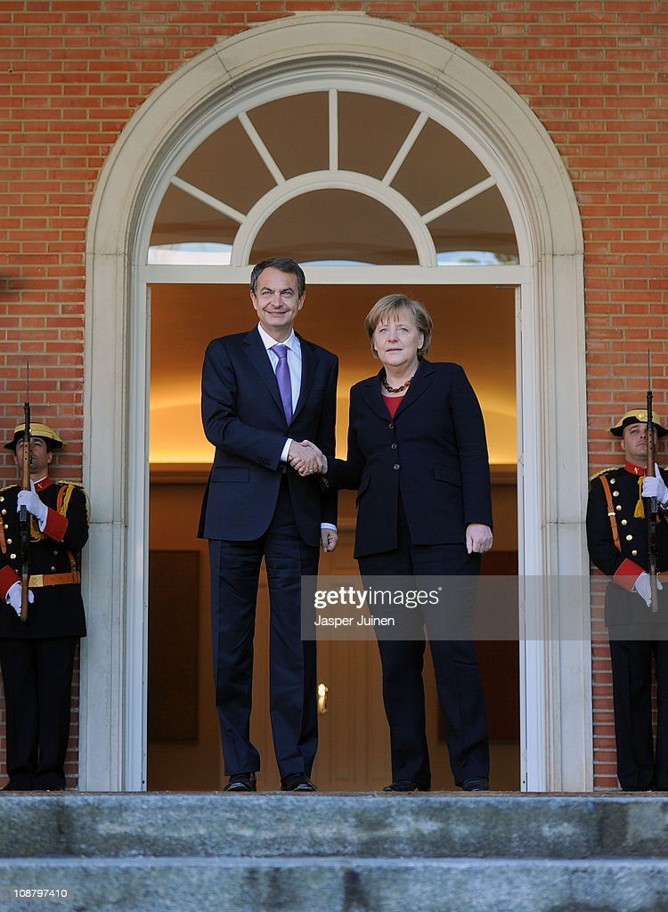 Spain's Prime Minister Jose Luis Rodriguez Zapatero (L) greets German Chancellor Angela Merkel upon her arrival at La Moncloa Palace on February 3, 2011 in Madrid, Spain. Merkel is visiting Spain with her finance and economy ministers for a one day official visit.