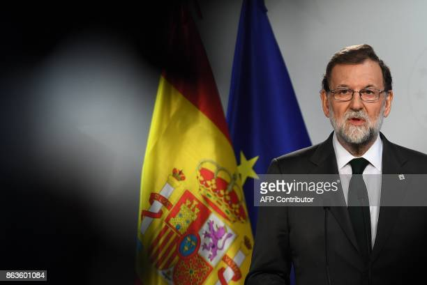 TOPSHOT Spain's Prime Minister Mariano Rajoy addresses a press conference at the end of an European leaders' summit in Brussels on October 20 2017 /...