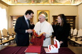 Spain's Prime Minister Mariano Rajoy along with by his wife Elvira Rodriguez gives a present of a jersey shirt of the Spanish national football team...