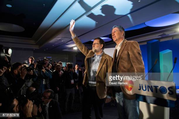 Spain's Prime Minister Mariano Rajoy and the President of the Popular Party of Catalonia Xavier Garcia Albiol arrive at a PPC rally on November 12...