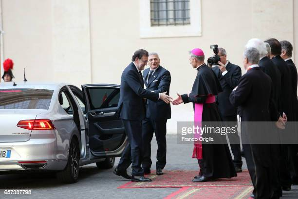 Spain's Prime Minister Mariano Rajoy Brey is welcomed by the prefect of the papal household Georg Gaenswein as he arrives at the Apostolic Palace for...