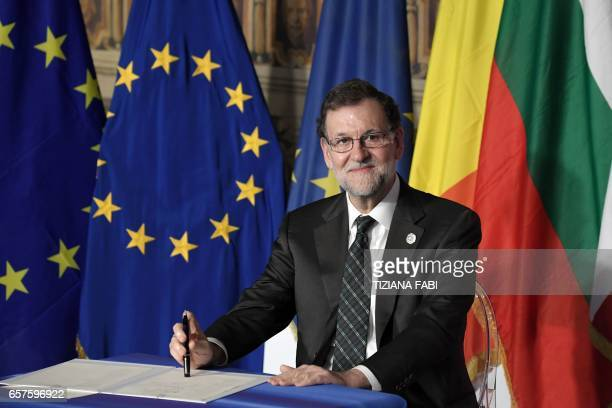Spain's Prime Minister Mariano Rajoy Brey signs the new Rome declaration with leaders of 27 European Union countries special during a summit of EU...