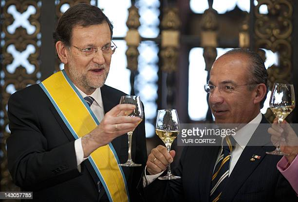 Spain's Prime Minister Mariano Rajoy makes a toast with Mexican President Felipe Calderon after he received the 'Decoration of the Order of The...