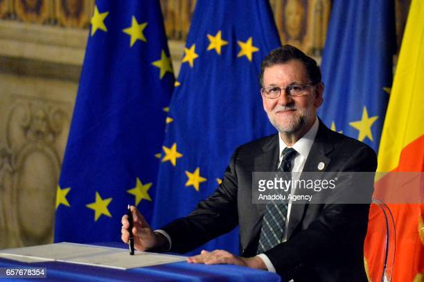 Spain's Prime Minister Mariano Rajoy poses for a photograph as he signs Rome declaration during the EU's 60th anniversary of the Rome at the Hall of...