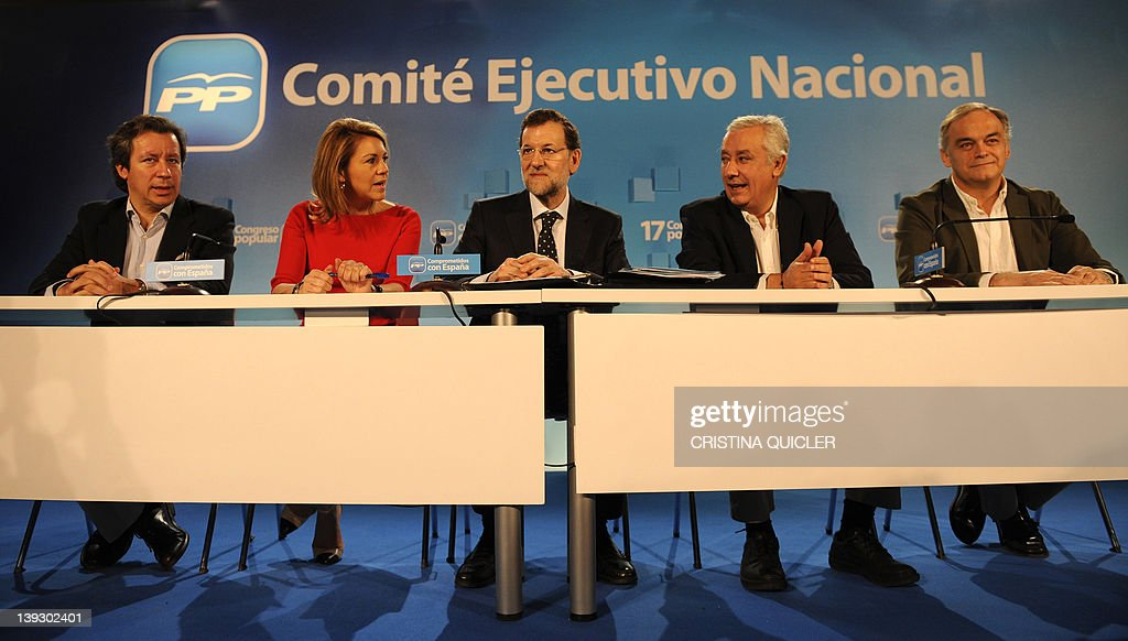 Spain's Prime Minister Mariano Rajoy poses with the new National Executive Committee consisting of Carlos Floriano Partido Popular party General...