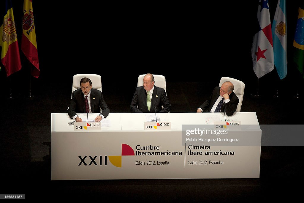 Spain's Prime Minister Mariano Rajoy (L) speaks on stage next to King Juan Carlos of Spain (C) and Secretary-General of the Ibero-American Secretariat (SEGIB) <a gi-track='captionPersonalityLinkClicked' href=/galleries/search?phrase=Enrique+Iglesias+-+Singer&family=editorial&specificpeople=202672 ng-click='$event.stopPropagation()'>Enrique Iglesias</a> (R) during the opening ceremony of the the XXII Ibero-American Summit at Falla Theatre on November 16, 2012 in Cadiz, Spain. The 22nd Ibero-American Summit is Mariano Rajoy's first as President of Spain and will be attended by 16 Foreign Affairs ministers. The main issues of the meeting will be the economic crisis and how Latin American countries can contribute to the Eurozone recovery.