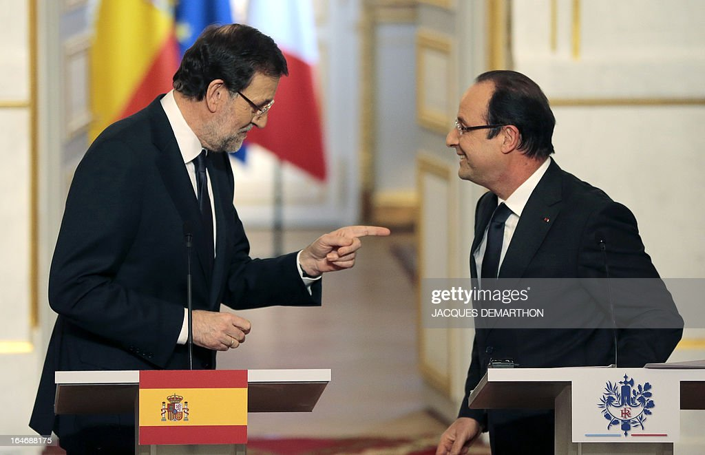 Spain's Prime Minister Mariano Rajoy (L) talks to France's President Francois Hollande during a joint press conference following a meeting on March 26, 2013 at the Elysee presidential Palace in Paris.