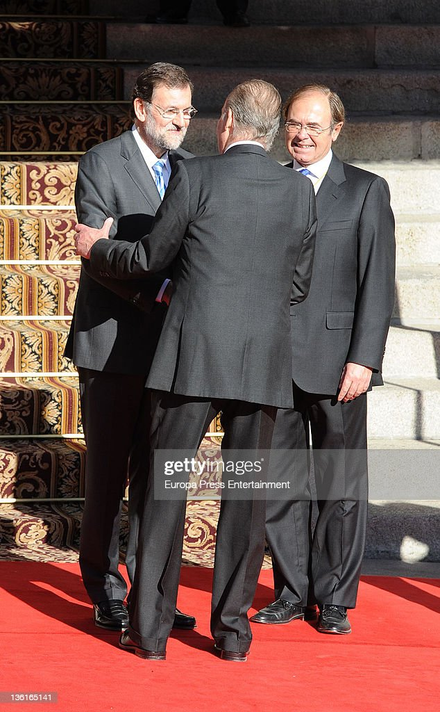 Spain's Prime Minister Mariano Rajoy talks with Spanish King Juan Carlos and Esteban GonzalezPons as they attend the first Parliament session with...
