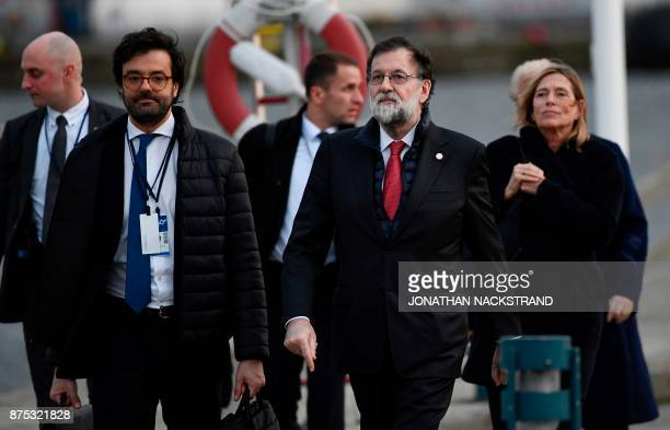 Spain's Prime minister Mariano Rajoy walks on a pier after leaving the luncheon during the European Social Summit in Gothenburg Sweden on November 17...
