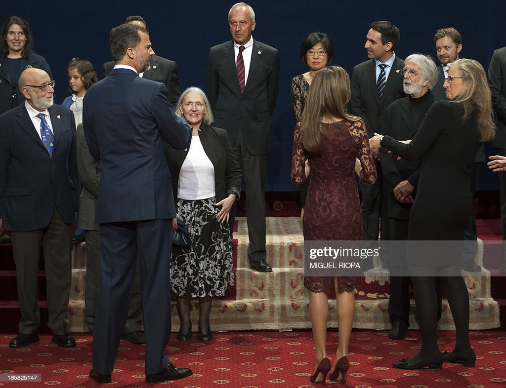 Spain's Prince Felipe and Princess Letizia arrive for a family picture with the 2013 Prince of Asturias Awards laureates at the Reconquista Hotel of the northern Spanish city of Oviedo on October 25, 2013. AFP PHOTO / MIGUEL RIOPA