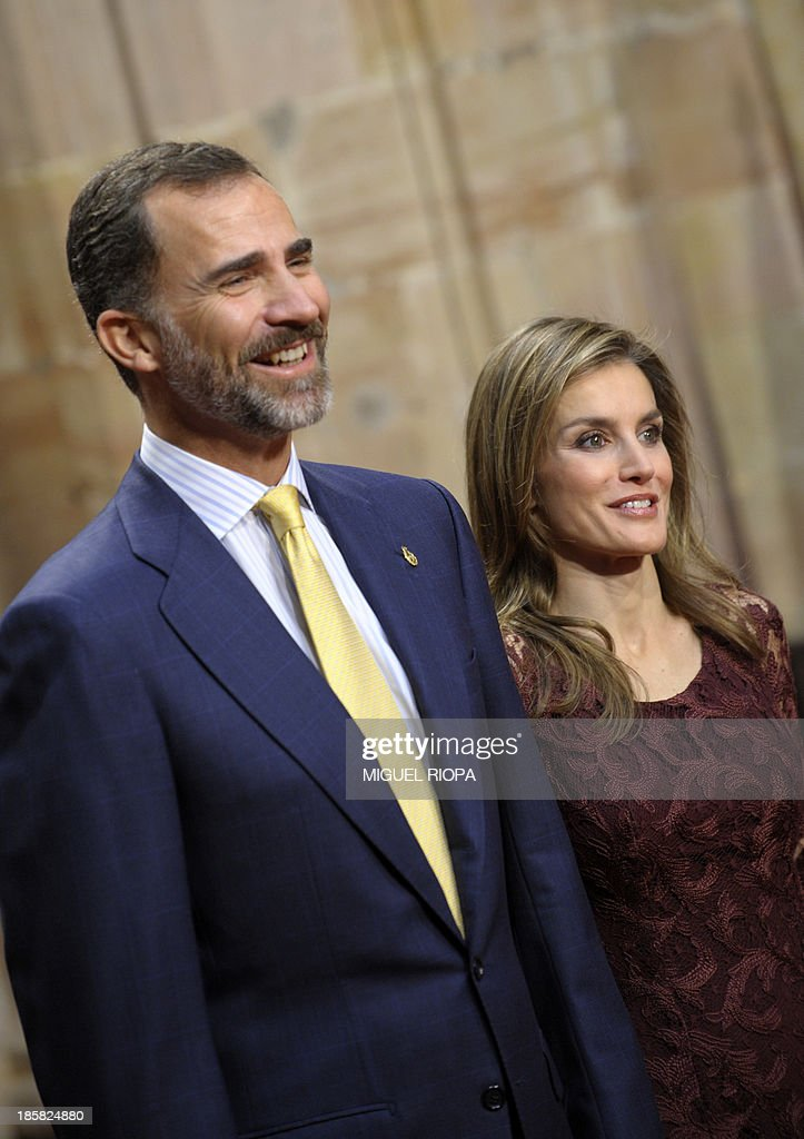Spain's Prince Felipe and Princess Letizia smile during an official audience of the 2013 Prince of Asturias Awards laureates at the Reconquista Hotel of the northern Spanish city of Oviedo on October 25, 2013.