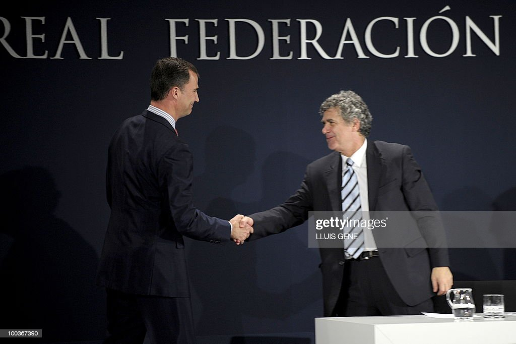 Spain's Prince Felipe (L) shakes hands with the President of the Spanish Football Federation (RFEF) Angel Maria Villar during the inauguration of RFEF museum on May 24, 2010 at the Sports City of Las Rozas, near Madrid. Spain, among the favourites for the World Cup, which runs from June 11-July 11, face Switzerland, Honduras and Chile in Group H of the opening round.