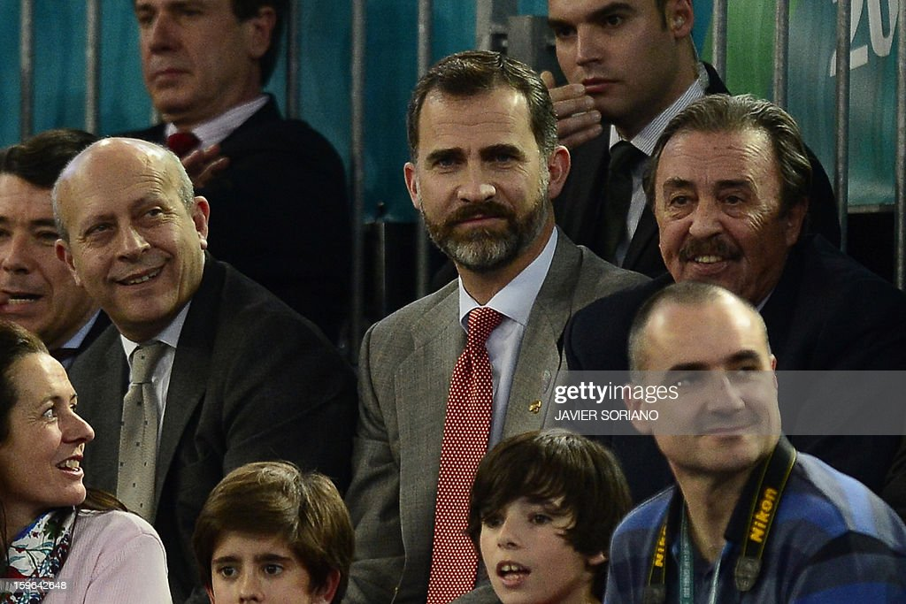 Spain's Prince Felipe (C), Spain's Culture Minister Juan Ignacio Wert (L) and Handball Spanish Federation President Juan de Dios Roman (R) attend the 23rd Men's Handball World Championships preliminary round Group D match Hungary vs Spain at the Caja Magica in Madrid on January 17, 2013.