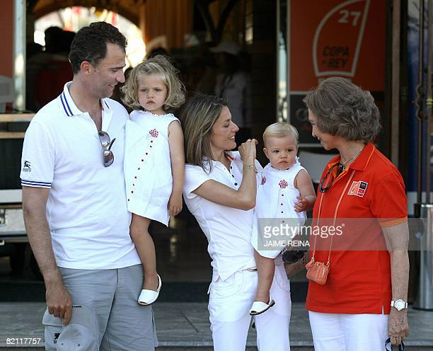 Spain's Princes Felipe and Letizia with their daughters Leonor and Sofia pose with Queen Sofia by the yacht club of Palma de Mallorca on July 29 2008...