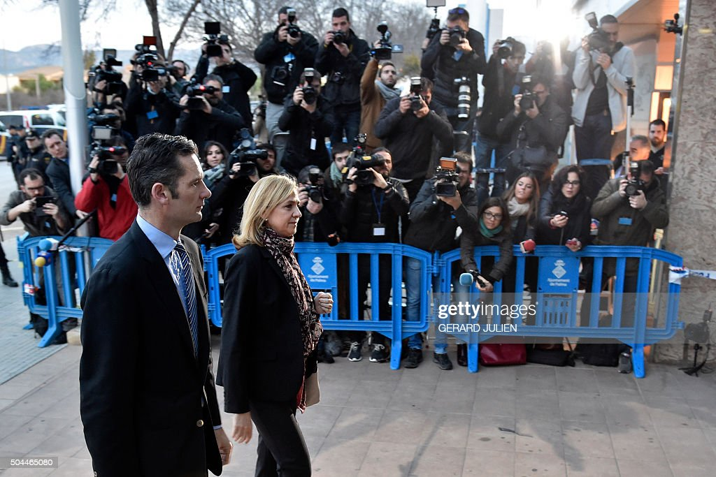 Spain's Princess Cristina (R) and her husband, former Olympic handball player Inaki Urdangarin arrive for a hearing held in the courtroom in the Balearic School of Public Administration (EBAP) building in Palma de Mallorca, on the Spanish Balearic Island of Mallorca on January 11, 2016. Spain's Princess Cristina, the sister of King Felipe VI, and her husband, former Olympic handball player Inaki Urdangarin, will go on trial on today for corruption in a high stakes case that risks inflicting further damage to the image of the Spanish monarchy.