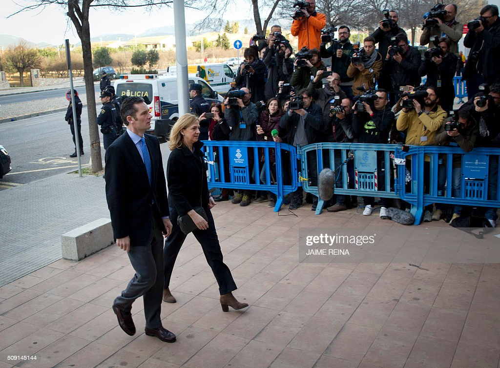 Spain's Princess Cristina (R) and her husband, former Olympic handball player Inaki Urdangarin arrive for a hearing held in the courtroom in the Balearic School of Public Administration (EBAP) building in Palma de Mallorca, on the Spanish Balearic Island of Mallorca on February 9, 2016. Spain's Princess Cristina, the sister of King Felipe VI, and her husband, former Olympic handball player Inaki Urdangarin, will go on trial today for corruption in a high stakes case that risks inflicting further damage to the image of the Spanish monarchy. / AFP / JAIME REINA