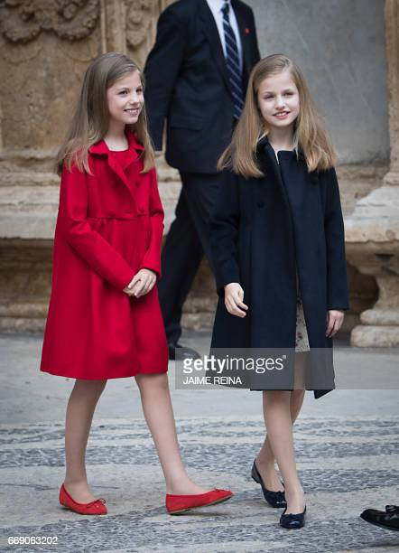 Spain's Princess Leonor and her sister Sofia smile after attending the traditional Mass of Resurrection in Palma de Mallorca on April 16 2017 / AFP...