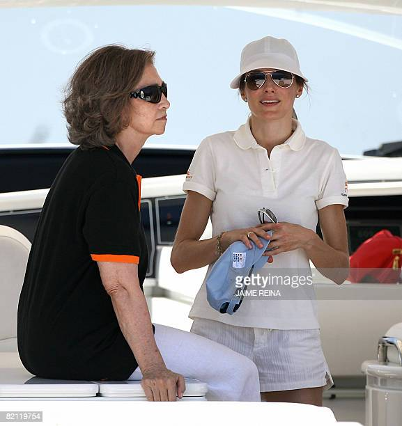 Spain's Princess Letizia and Queen Sofia watch the third day of racing in the Copa del Rey regatta off the coast of Palma de mallorca on July 30 2008...