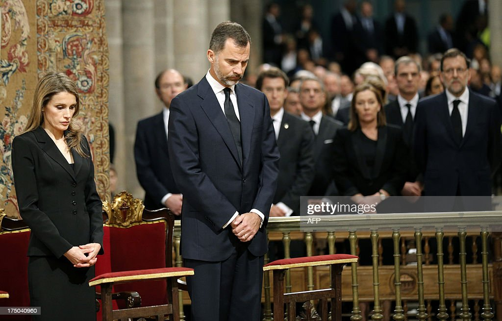 Spain's Princess Letizia (L), Spain's Crown Prince Felipe (2ndL) and Spanish Prime Minister leader Mariano Rajoy (R) attend a memorial service for the victims the derailed train of Angrois, at the cathedral of Santiago de Compostela on July 29, 2013. The driver of a train that hurtled off the rails in Spain was charged on July 28 with 79 counts of reckless homicide and released on bail after being questioned by a judge.