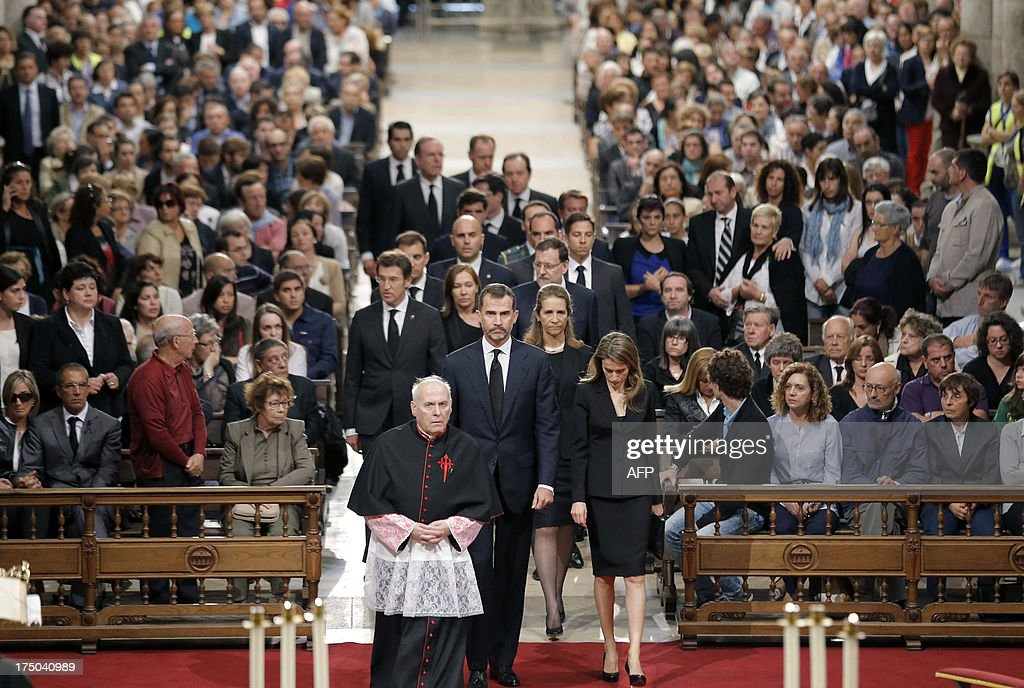 Spain's Princess Letizia (FrontR), Spain's Crown Prince Felipe (C), followed by Spain's Infanta Elena (2ndR) and Spanish Prime Minister leader Mariano Rajoy arrive to attend a memorial service for the victims the derailed train of Angrois, at the cathedral of Santiago de Compostela on July 29, 2013. The driver of a train that hurtled off the rails in Spain was charged on July 28 with 79 counts of reckless homicide and released on bail after being questioned by a judge.