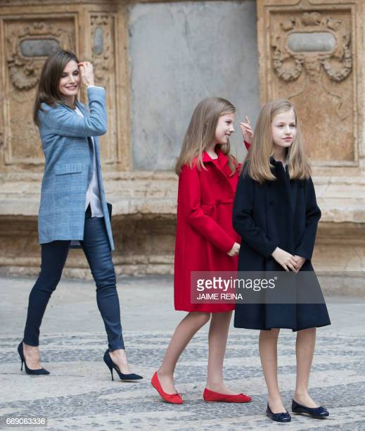 Spain's Queen Letizia and her daughters Princess Leonor and Sofia smile after attending the traditional Mass of Resurrection in Palma de Mallorca on...