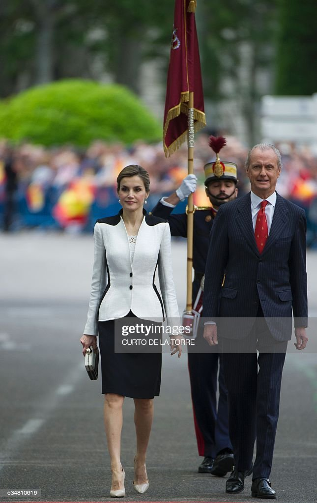 Spain's Queen Letizia (L) and Spanish defense Pedro Morenes walk on Lealtad Square during the 2016 Armed Forces Day parade in Madrid on May 27, 2016. / AFP /