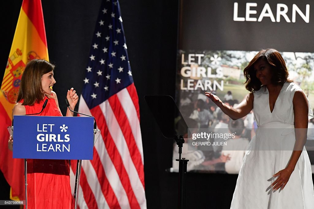 Spain's Queen Letizia (L) is greeted by US first lady Michelle Obama during the prensentation of the 'Let Girls Learn' initiative on June 29, 2016 in Madrid. First Lady Michelle Obama began a two day visit to Spain by delivering a speech on the education initiative launched in March 2015 to help adolescent girls across the world access a quality education. / AFP / GERARD