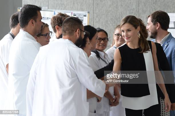 Spain's Queen Letizia shakes hands with medicall staff after visiting victims of the Barcelona attack at the Sant Pau hospital in Barcelona after on...