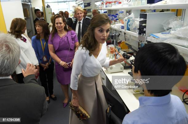 Spain's Queen Letizia speaks to research scientists during the visit to the Francis Crick Institute in central London on July 14 the third and final...