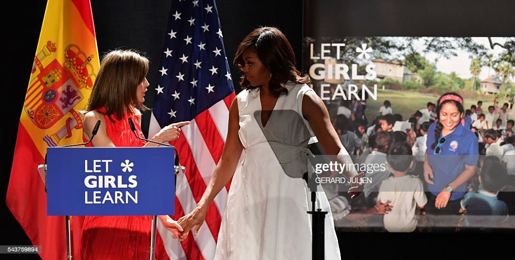 Spain's Queen Letizia (L) talks with US first lady Michelle Obama after the prensentation of the 'Let Girls Learn' initiative on June 29, 2016 in Madrid. US First Lady Michelle Obama began a two day visit to Spain by delivering a speech on the education initiative launched in March 2015 to help adolescent girls across the world access a quality education. / AFP / GERARD