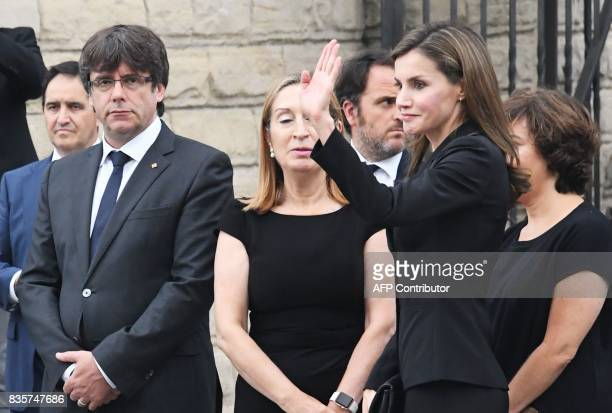 Spain's Queen Letizia waves as she arrives at a mass to commemorate victims of two devastating terror attacks in Barcelona and Cambrils at the...