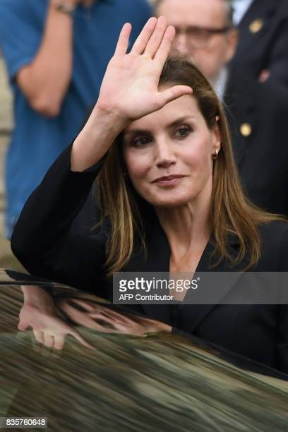 Spain's Queen Letizia waves as she leaves the Sagrada Familia church after a mass to commemorate victims of two devastating terror attacks in...