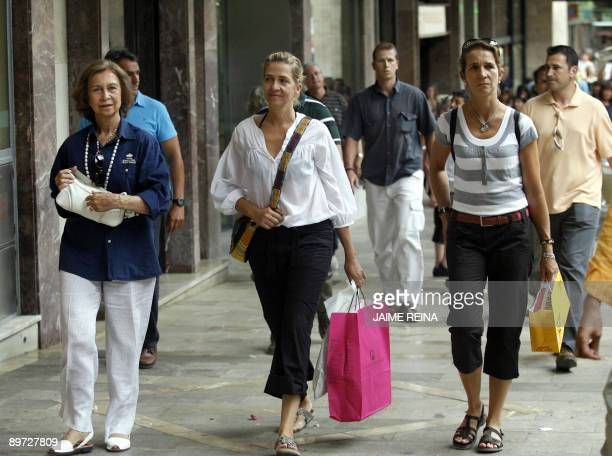Spain's Queen Sofia and her daughters Cristina and Elena walk in the central district of Palma de Mallorca on August 10 a day after three small bombs...