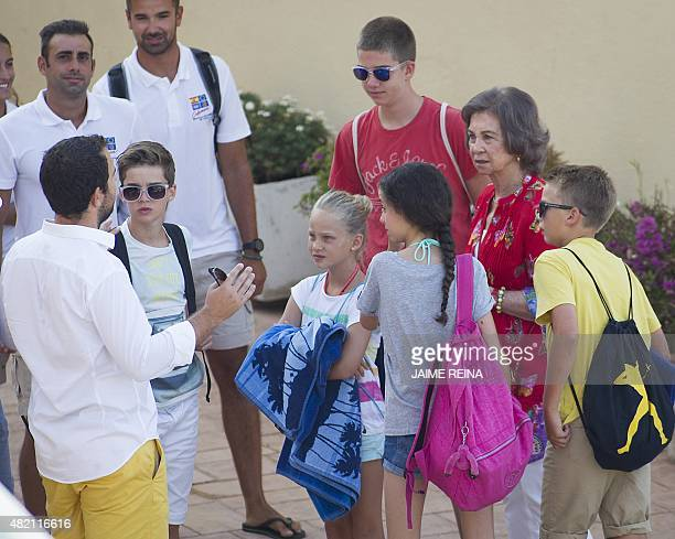 Spain's Queen Sofia and her grandchildren Pablo Nicolas Irene Victoria Federica Juan Valentin and Miguel listen to a sailing instructor on the first...