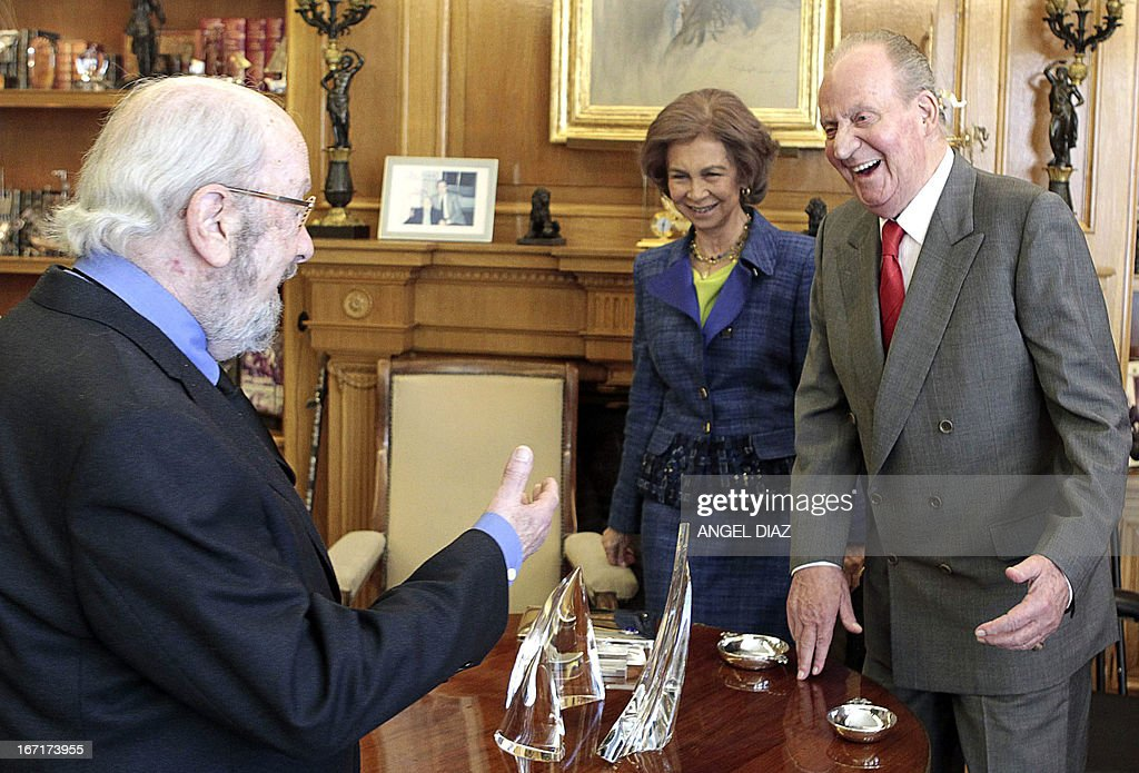 Spain's Queen Sofia (C) and Spain's King Juan Carlos (R) meet with the winner of the 2013 Literature Premio Cervantes award Jose Manuel Caballero Bonald (L) in Madrid on April 22, 2013. King Juan Carlos resumed his official activities today for the first time since he underwent a surgery on March 3 to fix slipped discs and a lumbar spinal stenosis, a condition in which the spinal canal narrows, causing back pain.