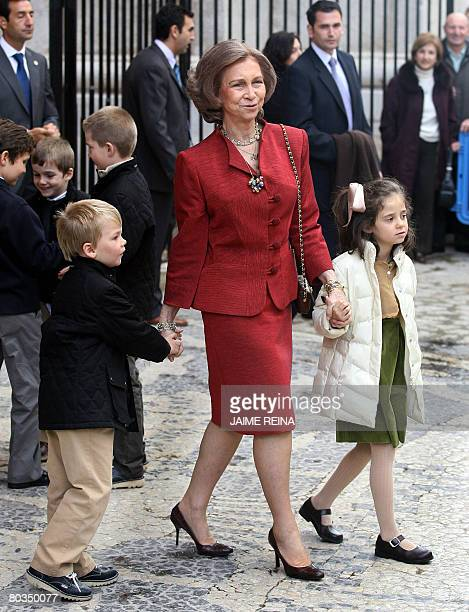 Spain's Queen Sofia holds her grand children Victoria Federica and Pablo after the traditional Mass of the Resurrection in Palma de Mallorca on March...