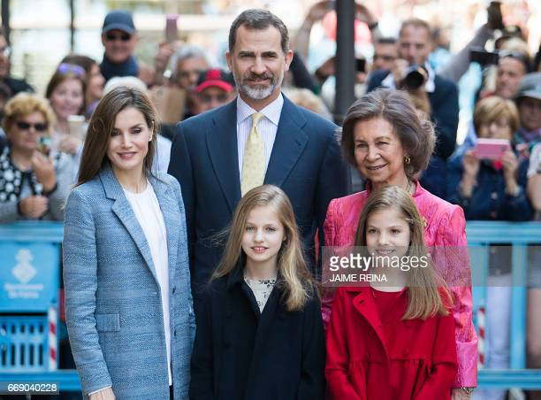 Spain's Queen Sofia King Felipe VI of Spain and his wife Queen Letizia and their daughters Princess Leonor and her sister Sofia pose before attending...